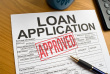 istockphoto_11975157-approved-loan-application-on-a-desktop.jpg